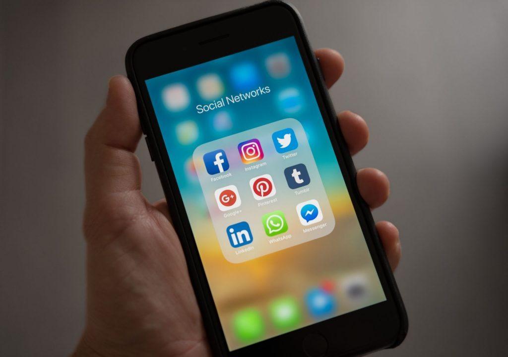 social media dental medical clinic in hand